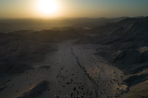 Aerial landscape photo with drone of sunrise at Hoanib river Namibia - Tomer Razabi