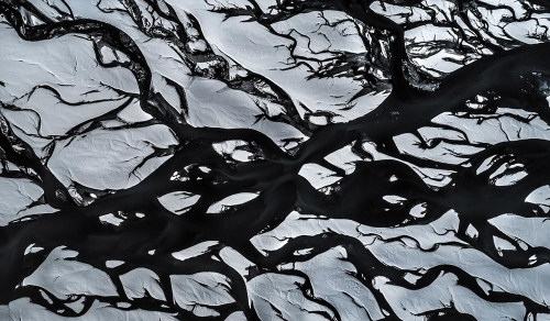 Landscape Aerial photo of a glacial river in Iceland - Tomer Razabi