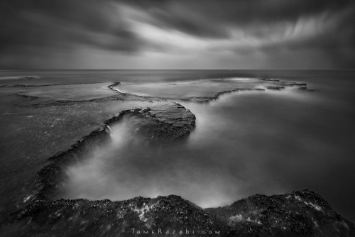 שקיעה בחוף פלמחים צילום נוף בחשיפה ארוכה - תומר רצאבי