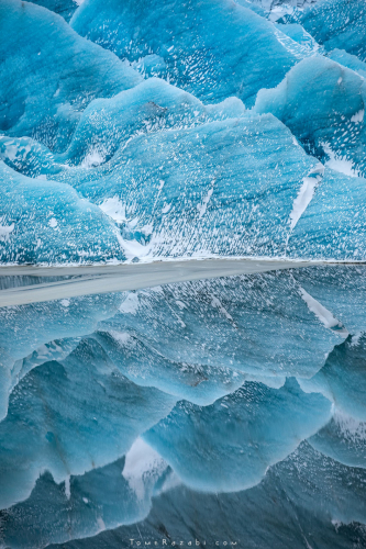 Glacier reflections at Svinafellsjokul in Iceland - Tomer Razabi